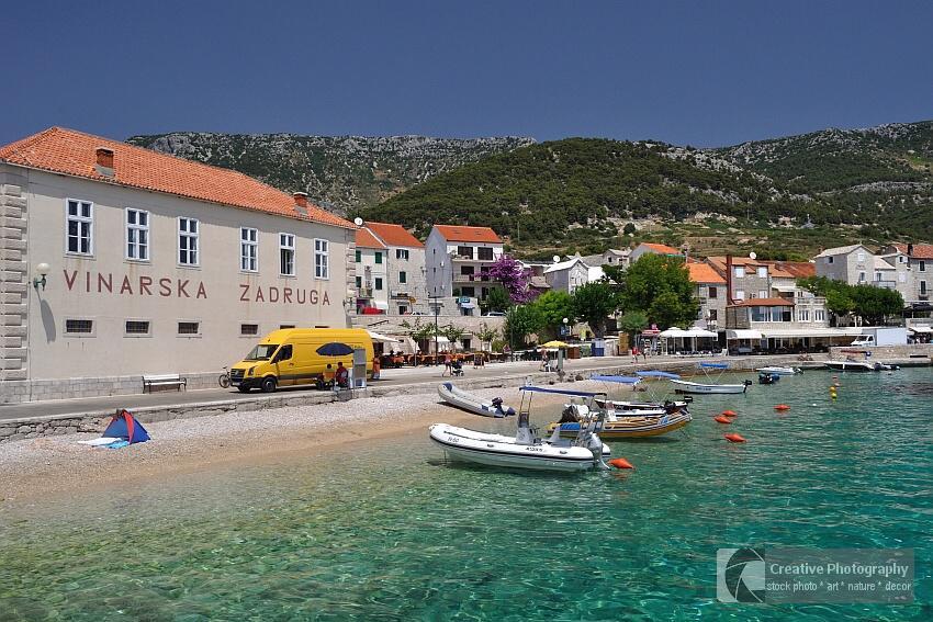 Beach of town Bol with crystal clear water on Island Brac in Croatia