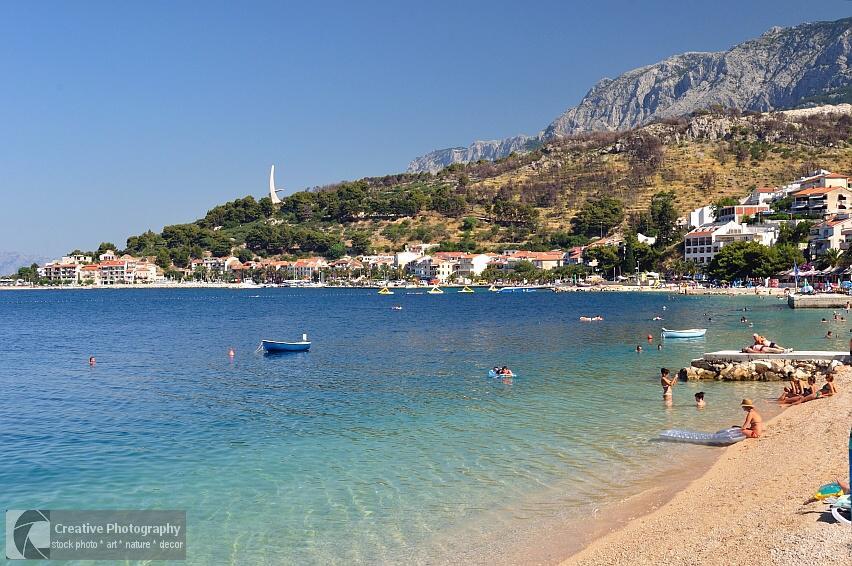 Beautiful beach of Podgora in Croatia with mountain Biokovo in background
