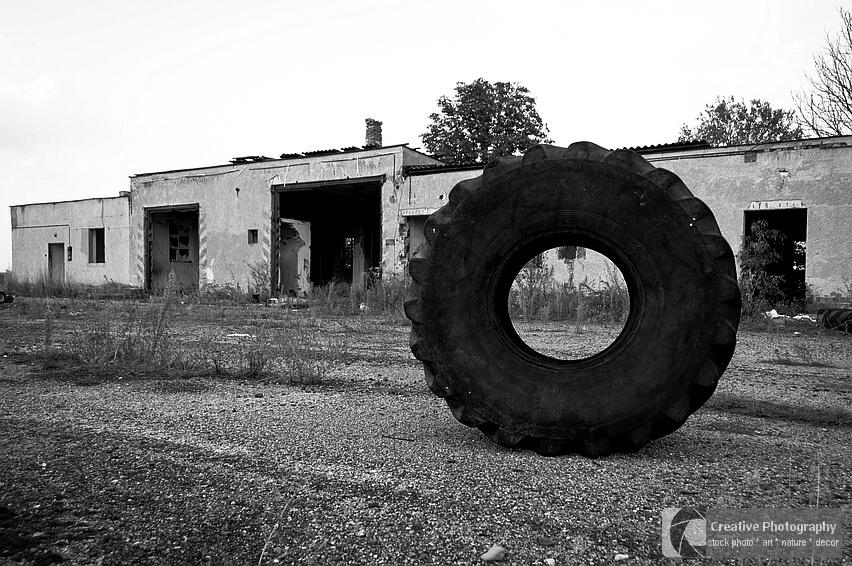 Big tyre in the abandoned factory