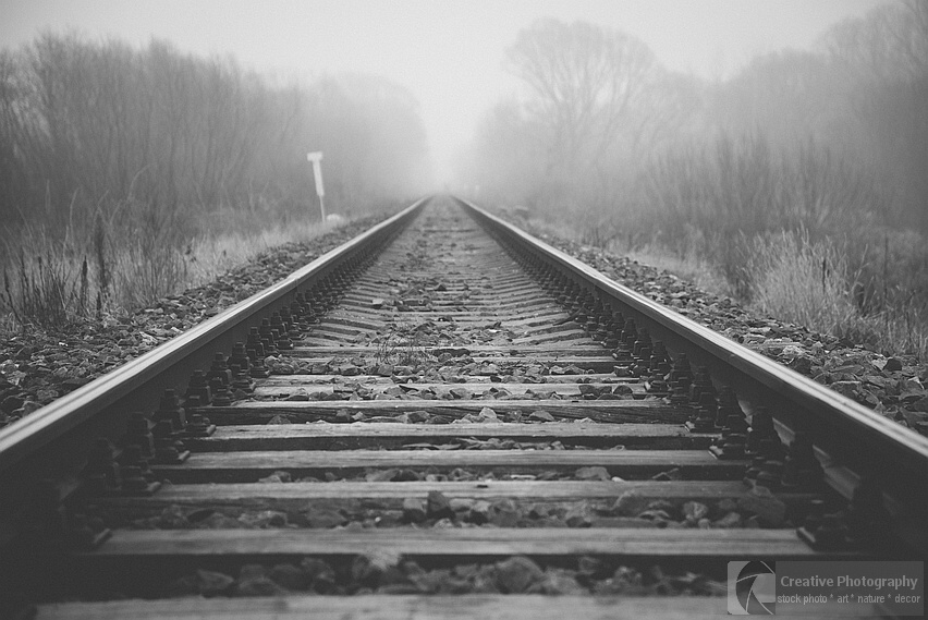 Railway going to the misty far away. Black and white photo