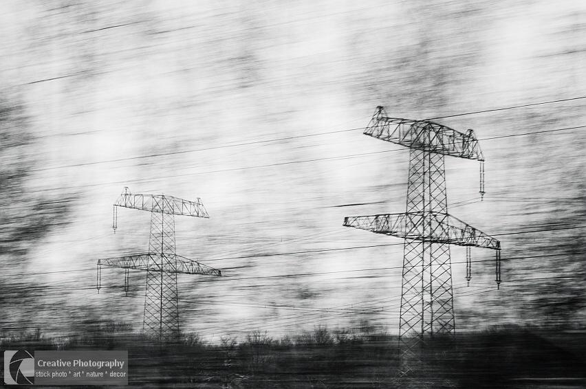 Electricity pylon in black and white photo