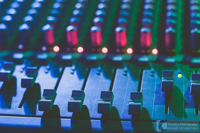 music mixer in blue light