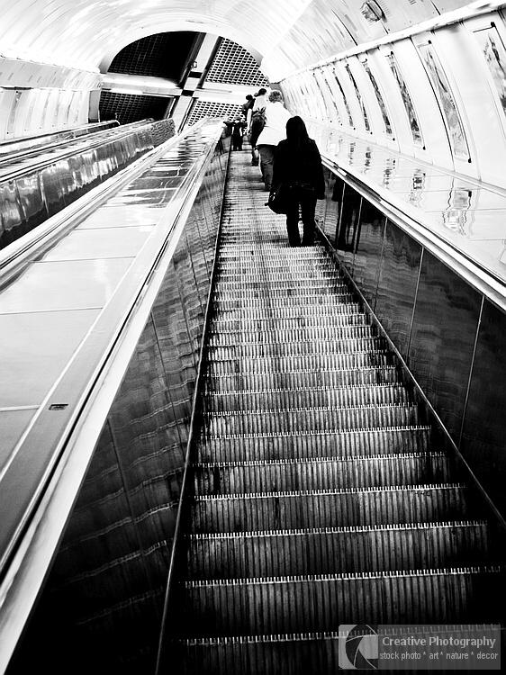People on the escalator. Black and white photo