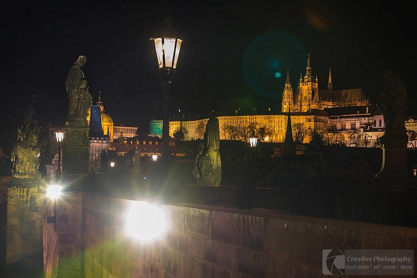 Charles bridge and the castle in night in Prague