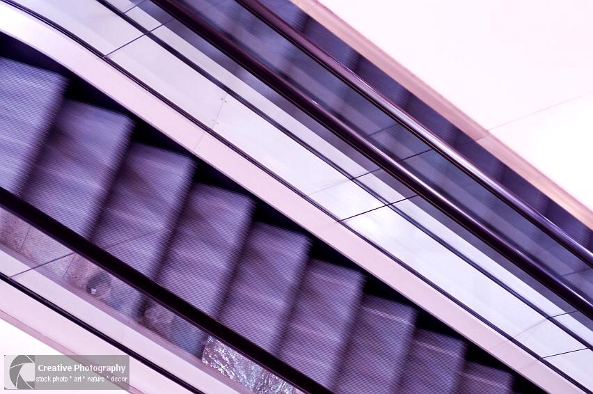 Purple escalator in abstract view