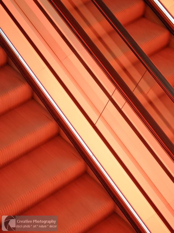 Red escalator in abstract view